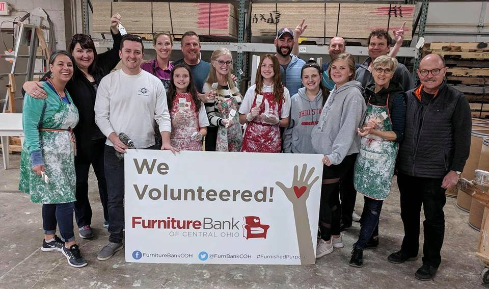 photo of volunteering at the Furniture Bank